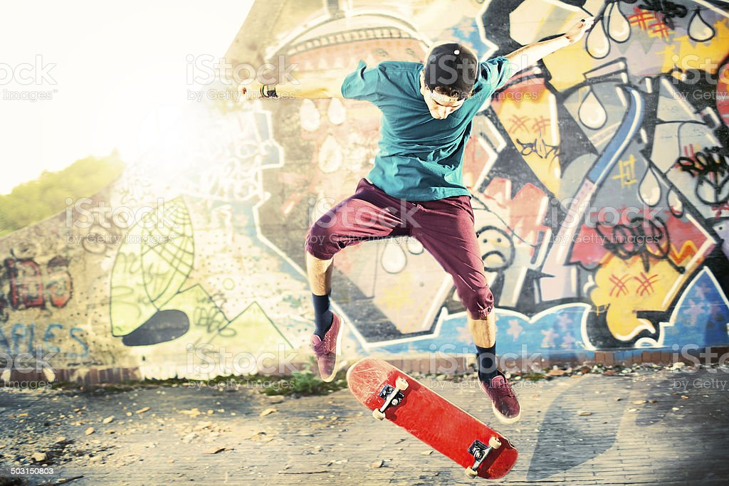 Skater in movement making a trick with his skate stock photo