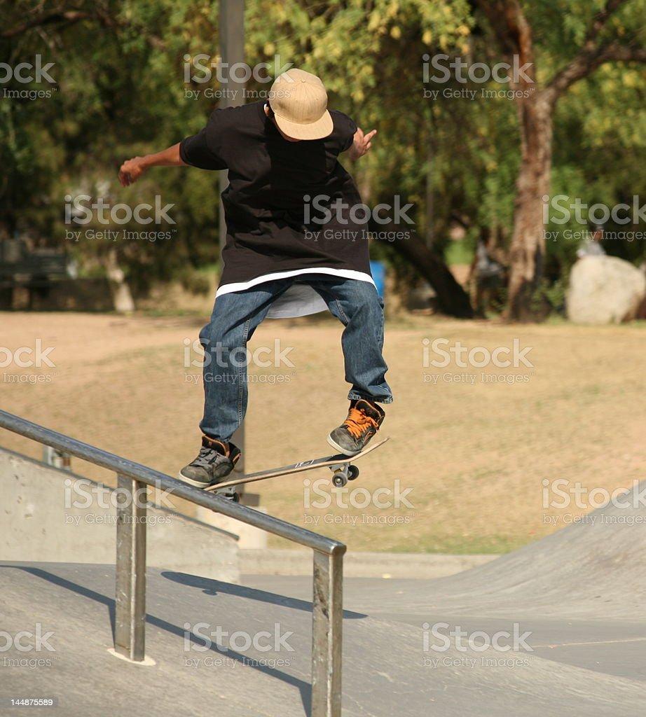 Skater in park doing tricks. stock photo