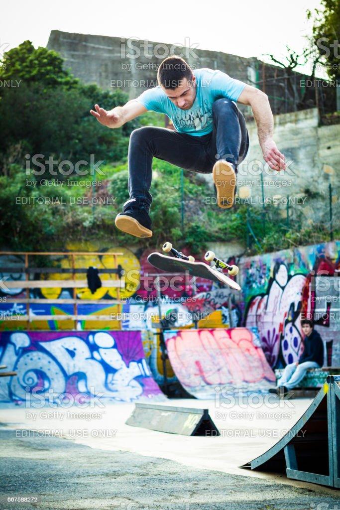 Skater make frontside flip stock photo