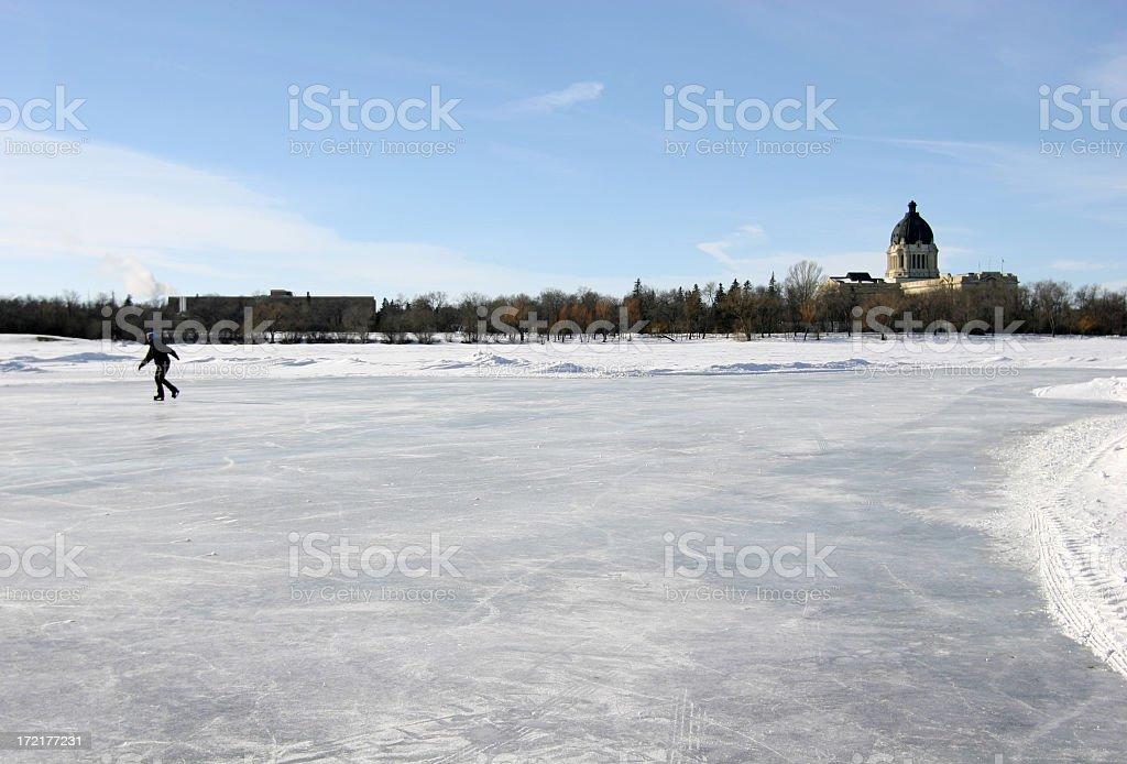 Skater on frozen Wascana Lake in Regina stock photo