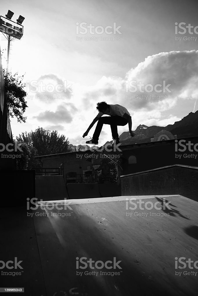 Skater silhouetted against the sky at sunset royalty-free stock photo