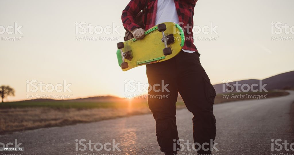 Skater with yellow skateboard stock photo