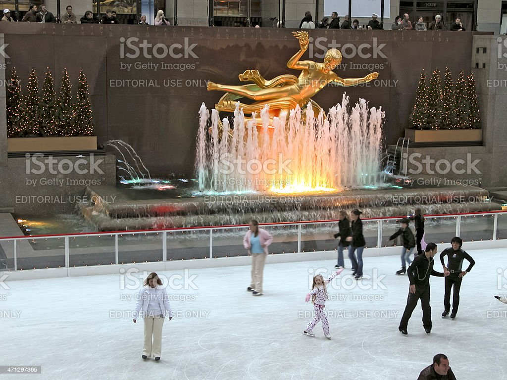 Skaters in front of Prometheus statue, Rockefeller Centre, NYC stock photo