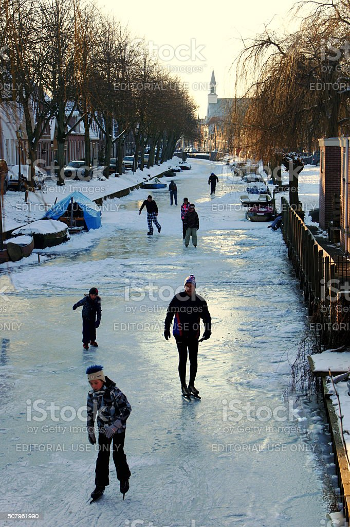 Skaters on the channel stock photo