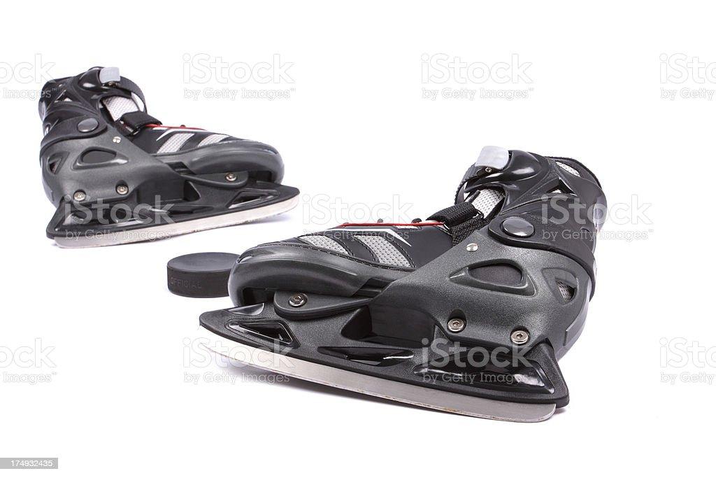 skates and puck royalty-free stock photo
