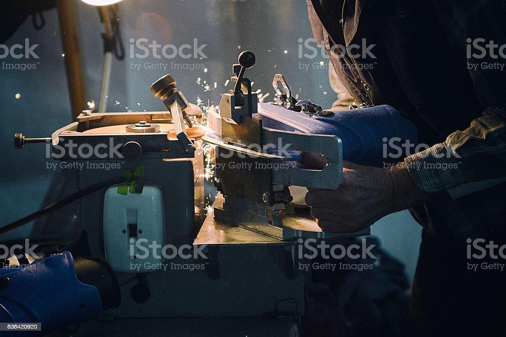 Skates sharpening machine stock photo