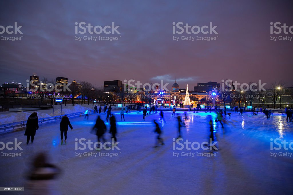 Skating in Montreal Marche Bonsecours at dusk stock photo