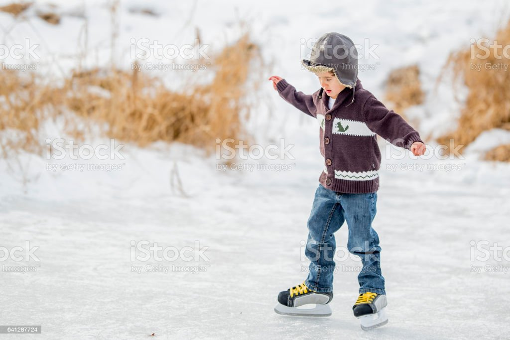 Skating on a Frozen Lake stock photo