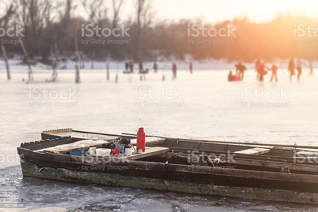Skating on frozen lake stock photo