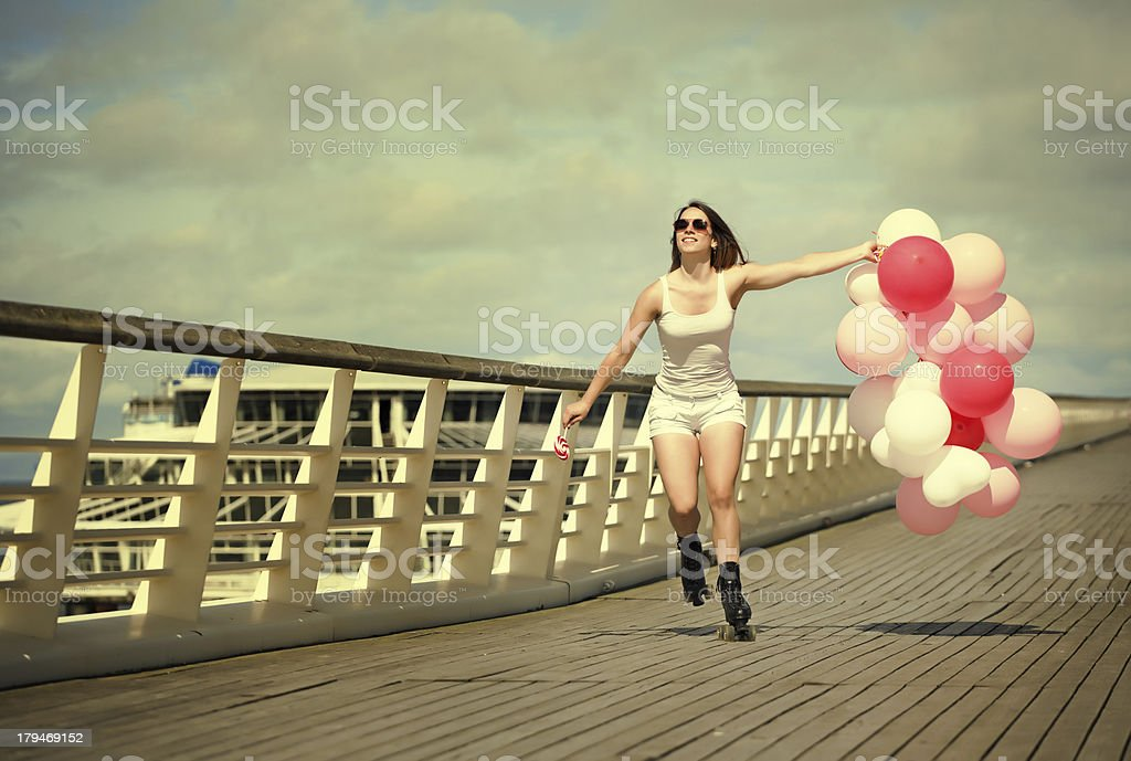 skating outdoors woman  with the balloons stock photo