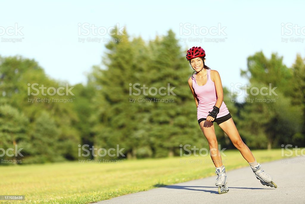 Skating woman on rollerblades stock photo