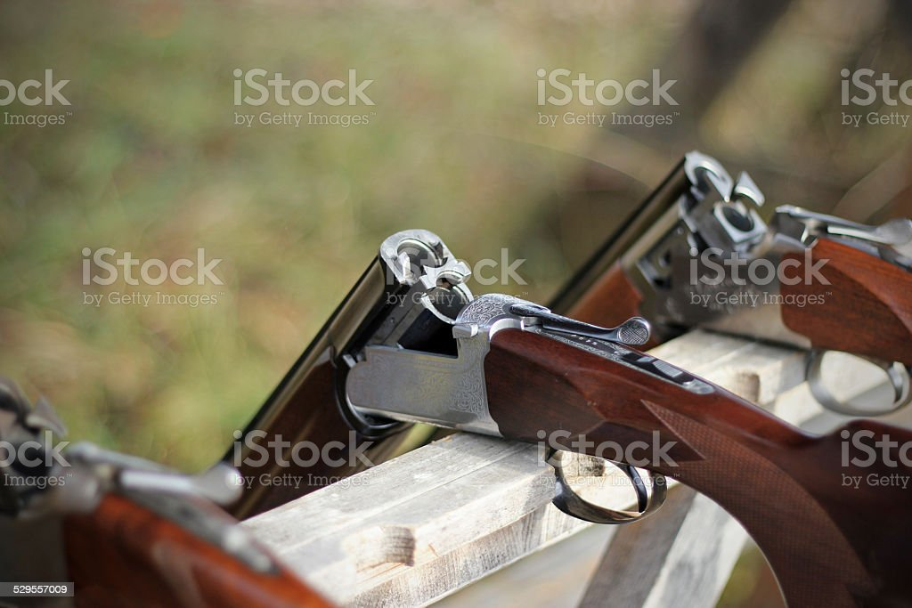Skeet shooting, closeup of several shotguns in line stock photo