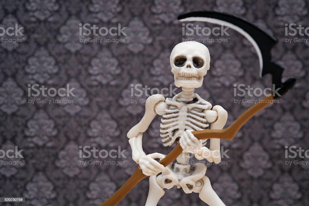 Skeleton and scythe stock photo