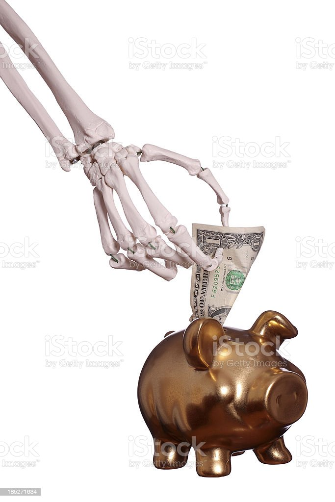 skeleton hand with dollar and piggybank stock photo