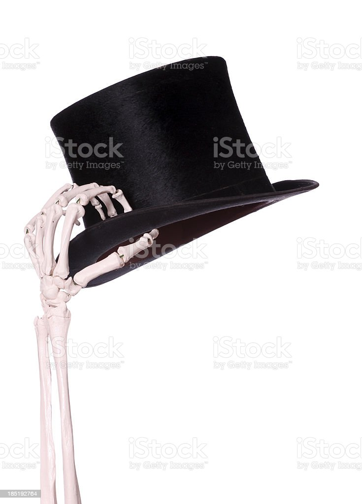 skeleton hand with old hat stock photo