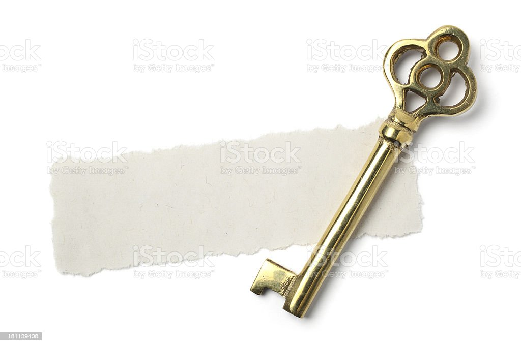 Skeleton key on a torn piece of blank paper royalty-free stock photo
