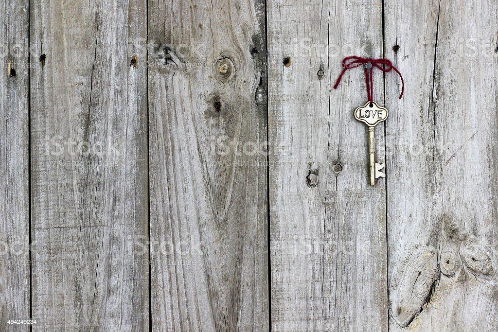 Skeleton key with ribbon hanging on door stock photo