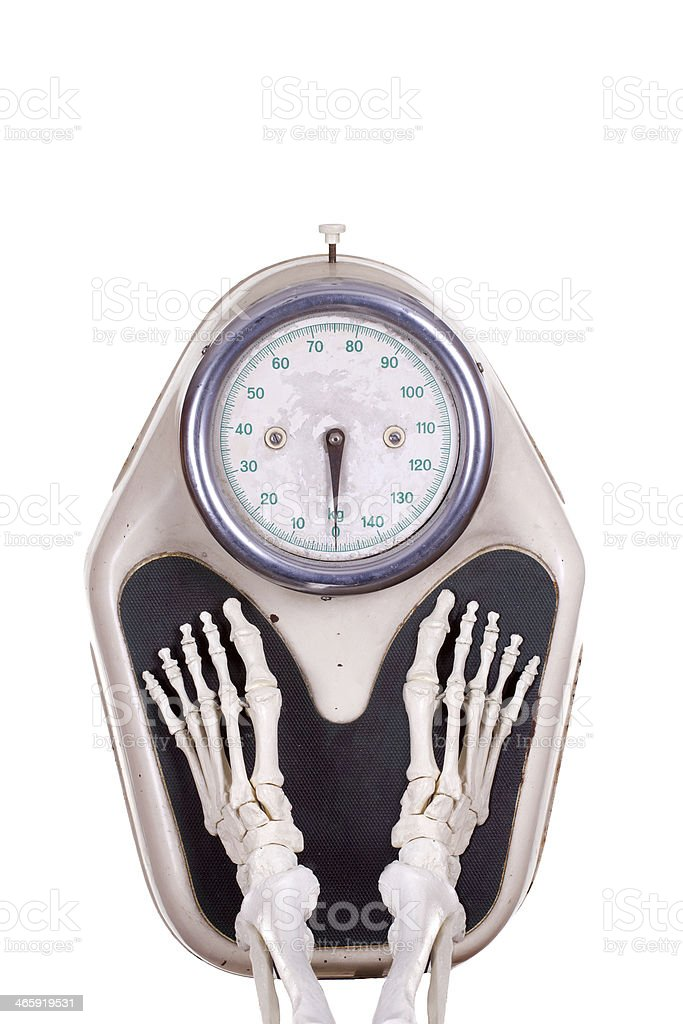 skeleton legs on scale stock photo