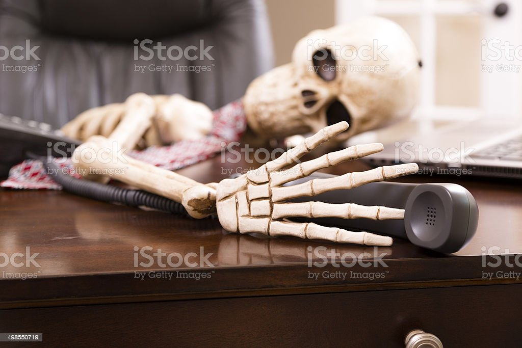 Skeleton of man who died while waiting 'on hold'.  Telephone. stock photo
