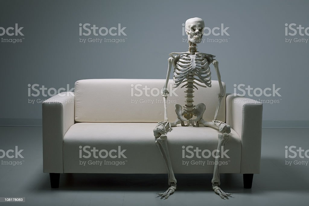 Skeleton on a couch stock photo