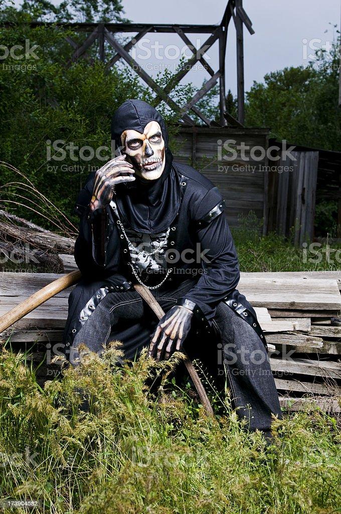 Skeleton on cellphone stock photo