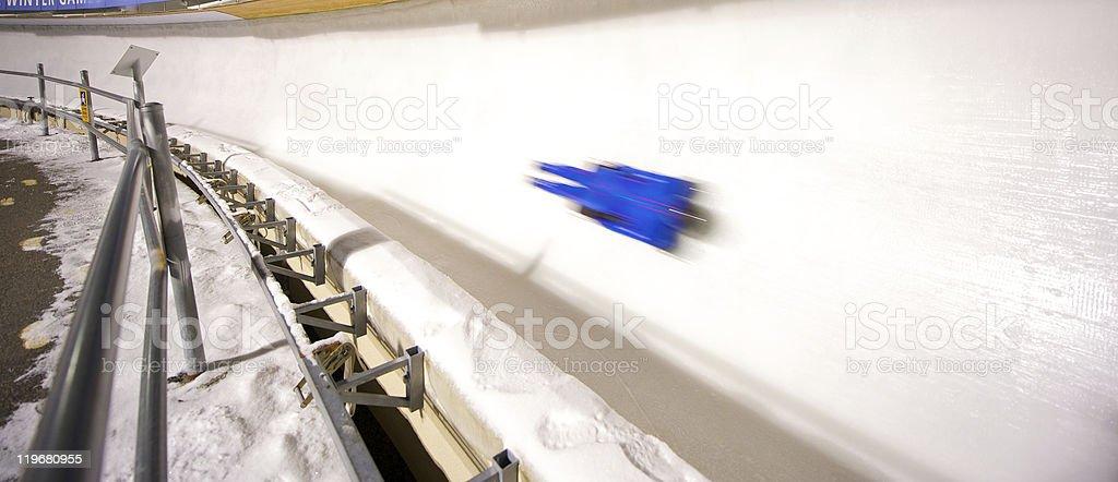 Skeleton racer slides down track. stock photo