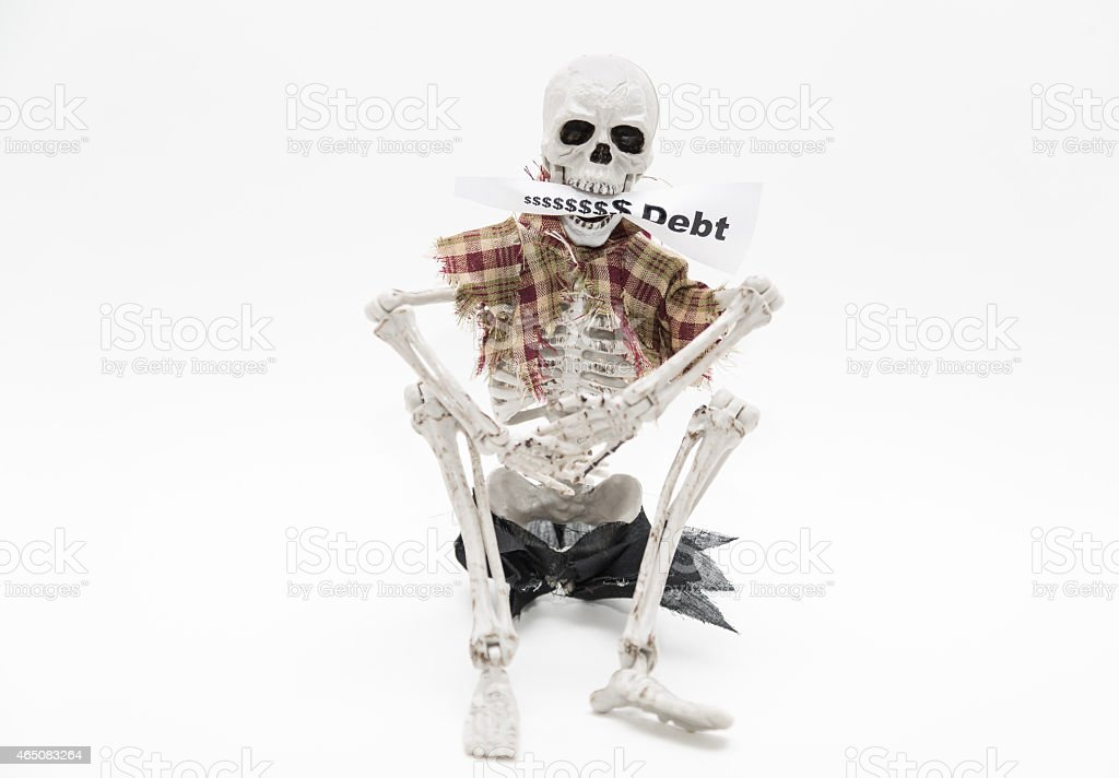 Skeleton sitting and holding message tag in his jaws stock photo