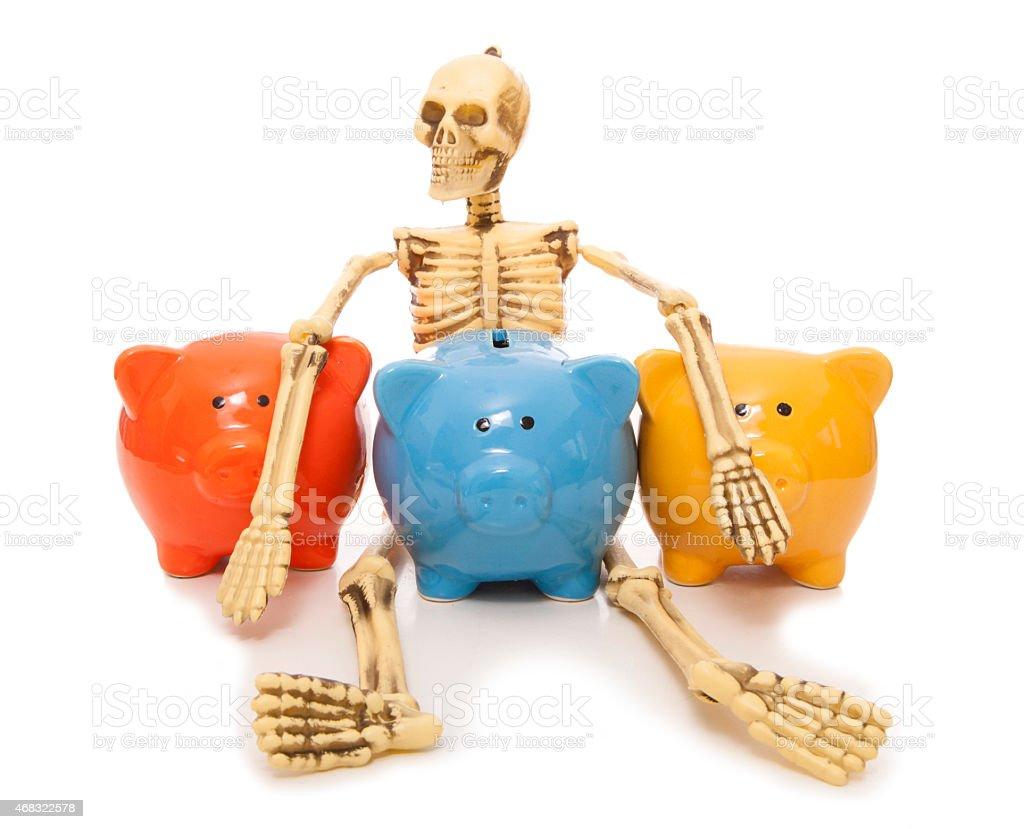 skeleton staff piggy bank stock photo