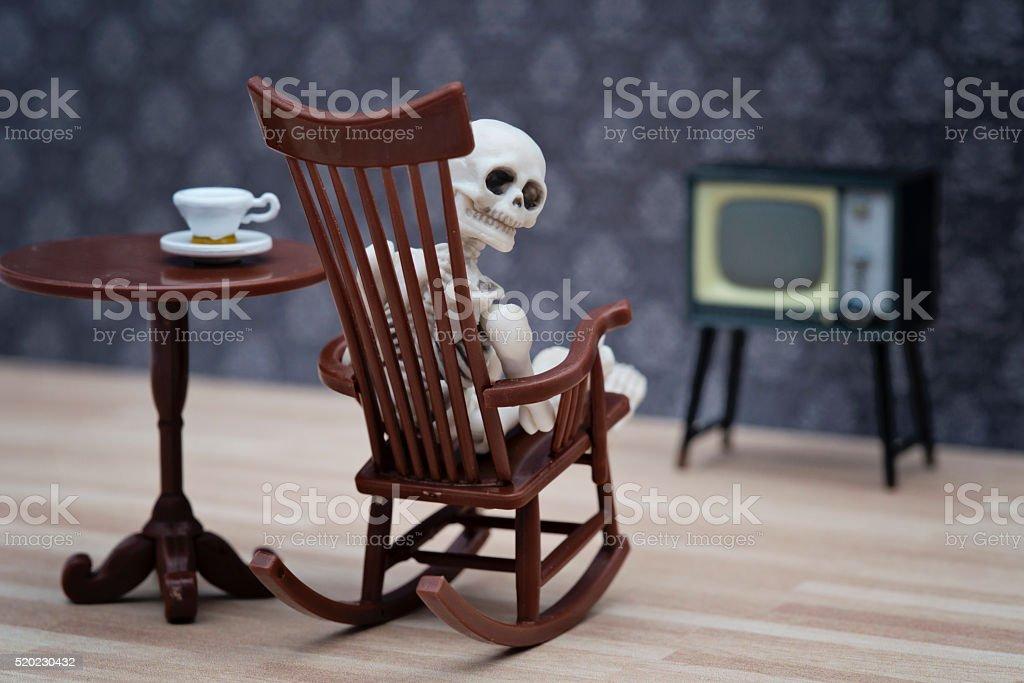 skeleton watching TV stock photo