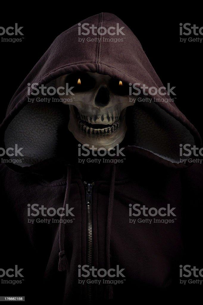 Skeleton Wearing hoodie with flaming eyes stock photo