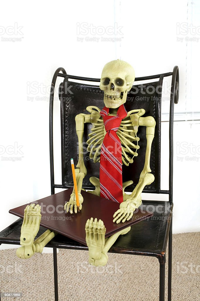 Skeleton wearing tie with notepad and pencil royalty-free stock photo