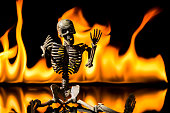 Skeleton with a fire background.