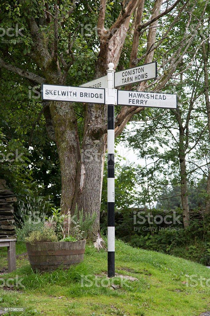 Skelwith Bridge, Coniston and Hawkshead Ferry Signpost; Lake Dis stock photo