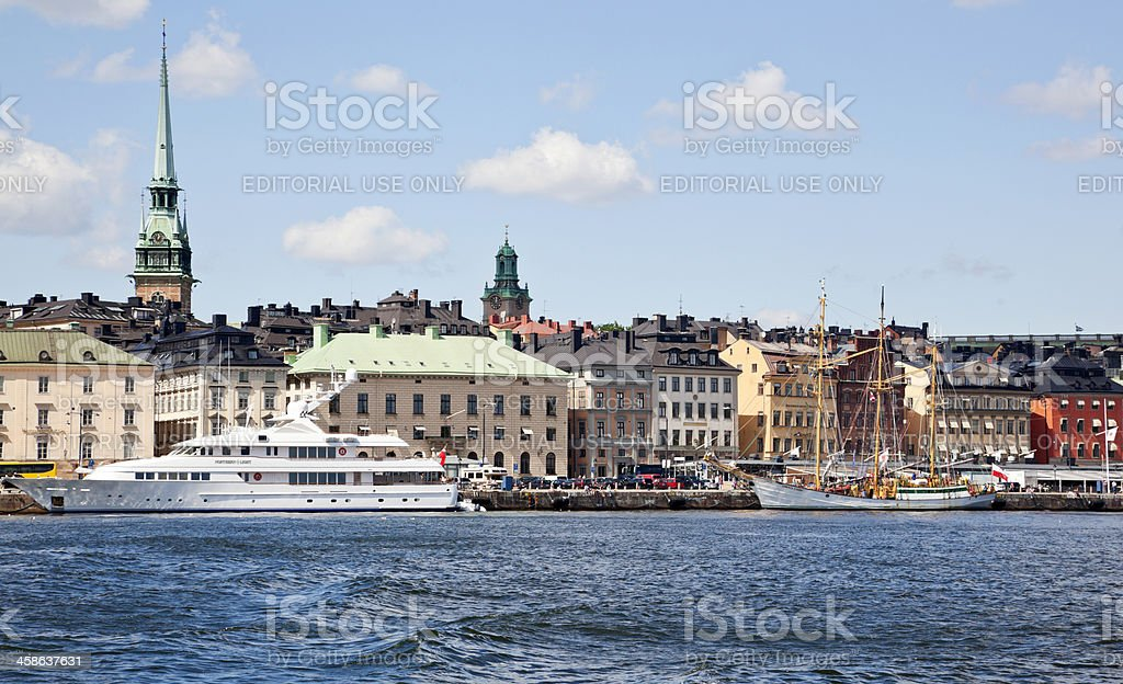 Skeppsbron Stockholm, luxary yacht at anchor, Gamla stan in background stock photo