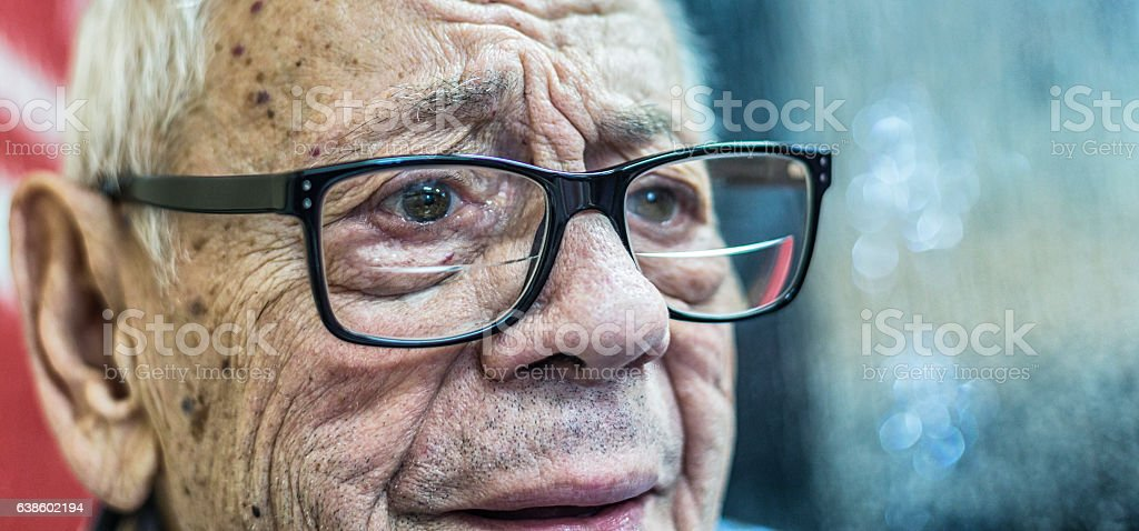 Skeptical Authentic Real Person Senior Adult Man Listening To Discussion stock photo