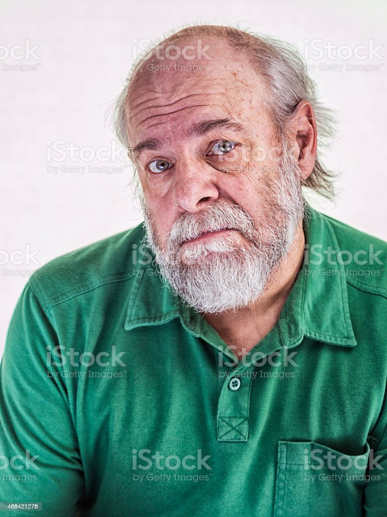 Skeptical Balding Senior Adult Man Human Face Expression stock photo
