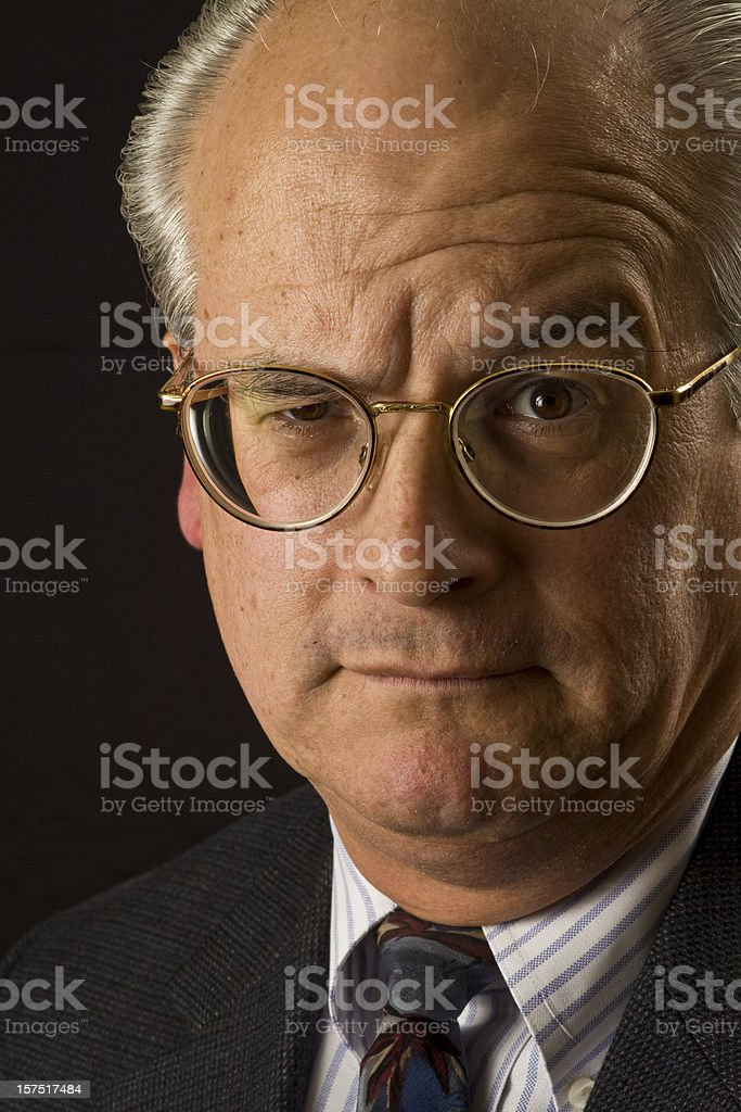 Skeptical Lawyer Raising One Eyebrow royalty-free stock photo