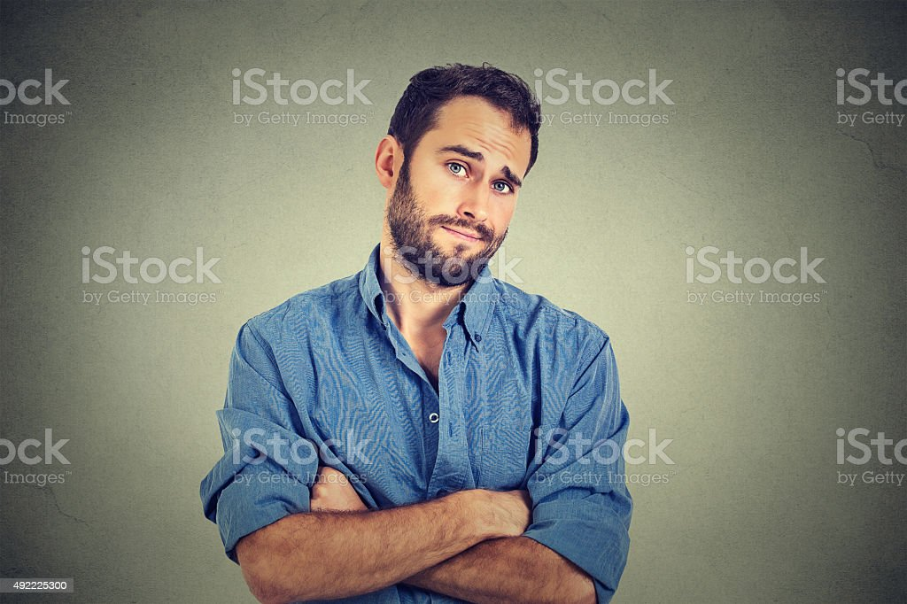 skeptical man looking suspicious, disgust on his face stock photo
