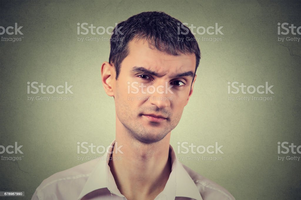 skeptical man looking suspicious, some disgust on his face mixed with disapproval stock photo