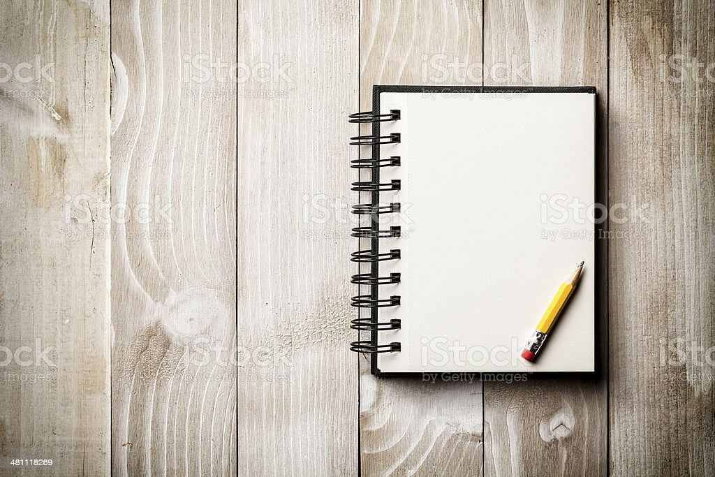 Sketch Block on Vintage Wood - Pencil Notepad Diary Backgrounds stock photo