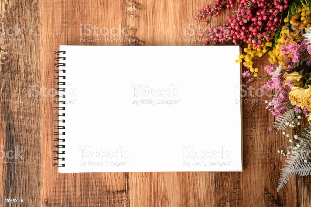 Sketch book on wooden board stock photo