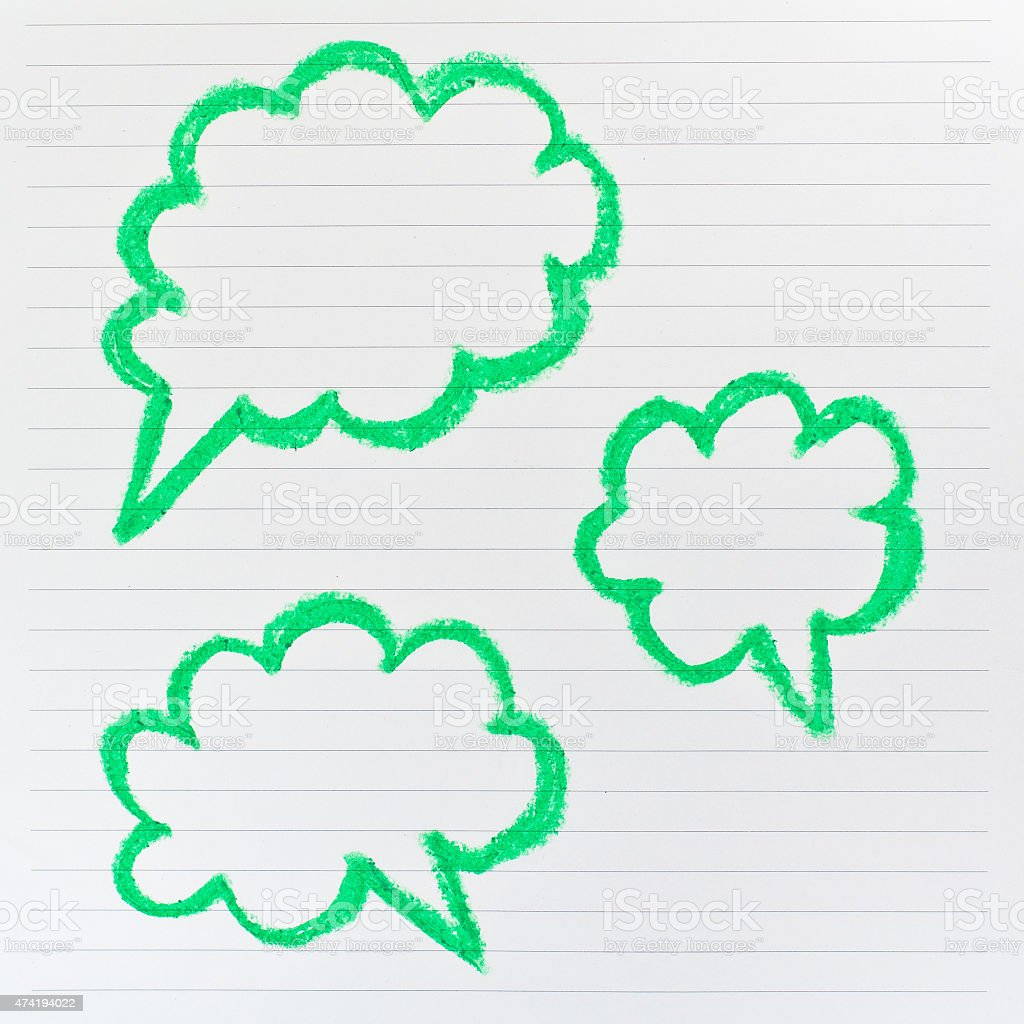 Sketch of green speech bubble on the lined paper stock photo