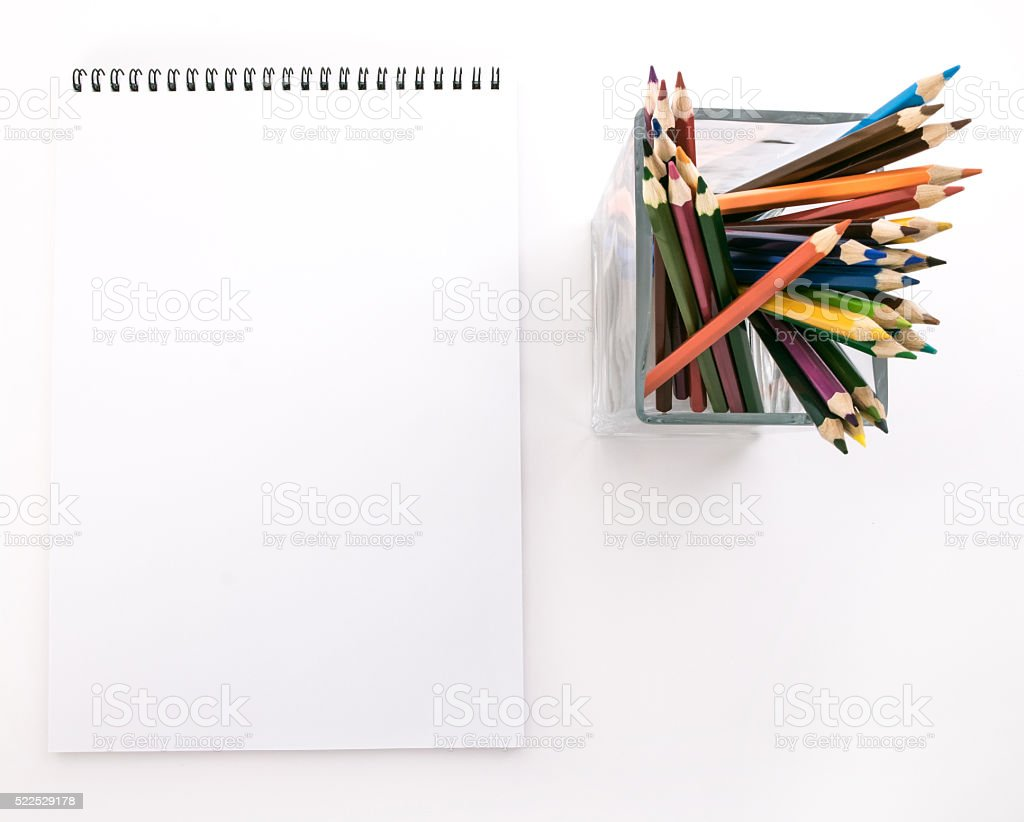 sketch pad and colored pencils stock photo