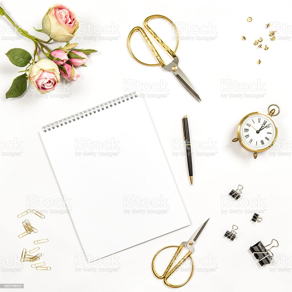 Sketchbook, flowers, office tools. Flat lay notebook stock photo