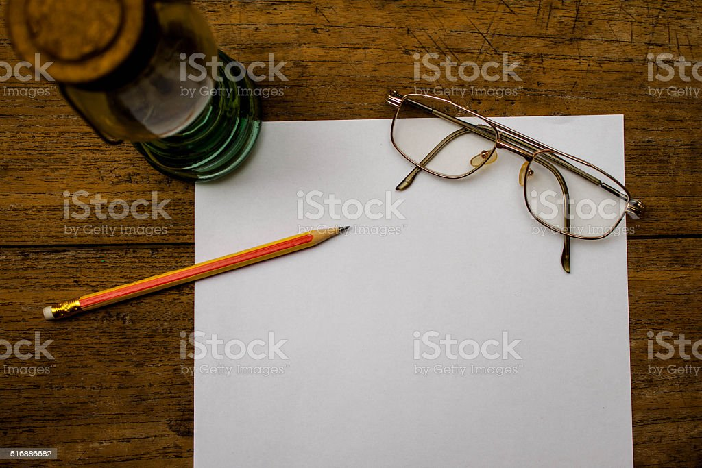 Sketchbook or Notebook with Pencil on Old Wooden Table stock photo