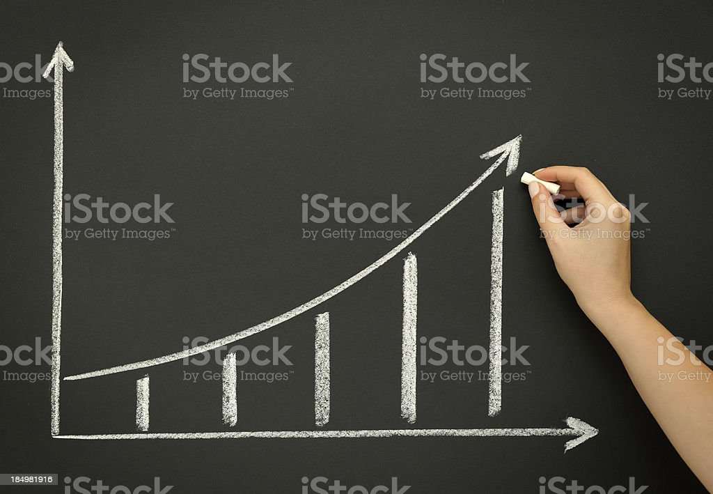Sketching growth chart on blackboard stock photo