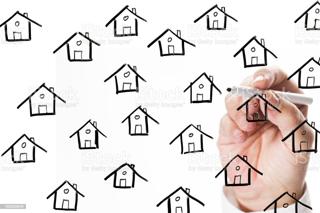 sketching houses on whiteboard royalty-free stock photo