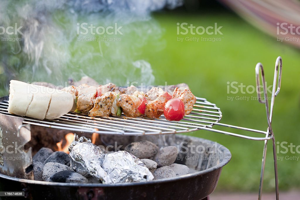 Skewer and meat on bbq grill royalty-free stock photo