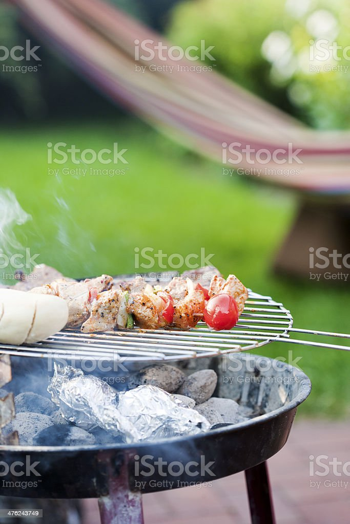 Skewer and meat on bbq grill stock photo