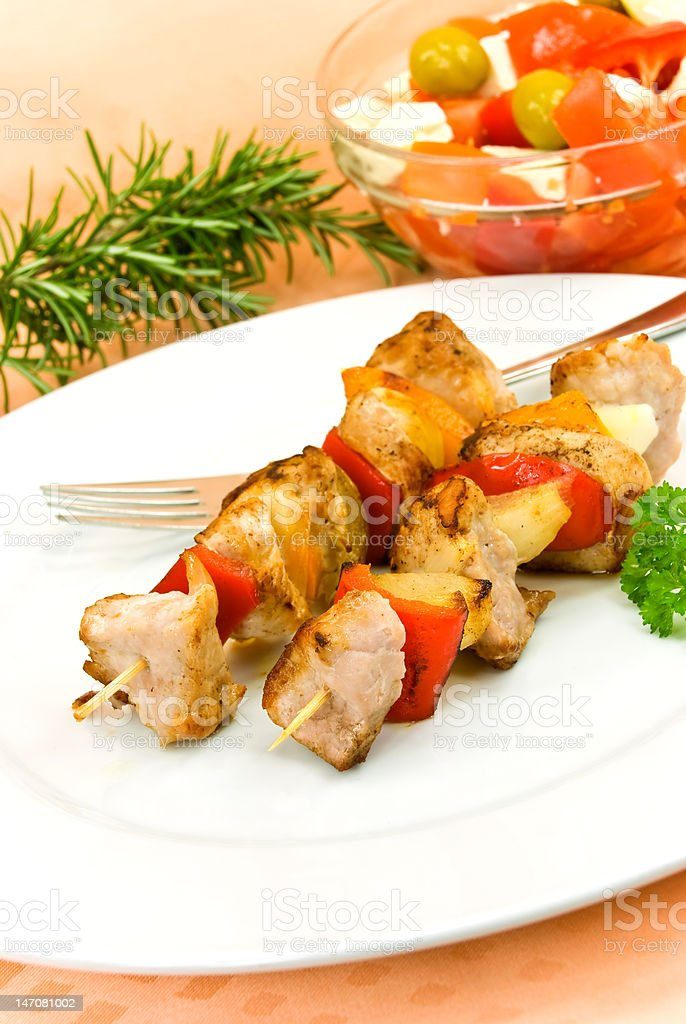 skewer on a plate ,mixed salad royalty-free stock photo
